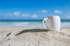 White espresso coffee cup with ocean , beach and seascape Stock Photos