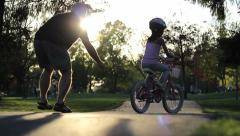 Little Girl Crashes Bike At The Park Stock Footage