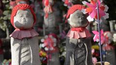 2 beatiful Japanese Child 'Jizo' Statues - stock footage