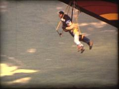 SUPER8 double hang glider landing Stock Footage