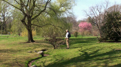 Photographer the spring of at the Brooklyn Botanical Garden. Stock Footage
