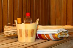 Toiletries and towels on shelf in sauna Stock Photos