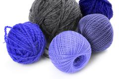 Few balls of wool on a white background Stock Photos