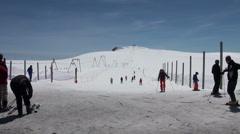 Skiers starting at the slope of Ski Paradise Matterhorn Stock Footage