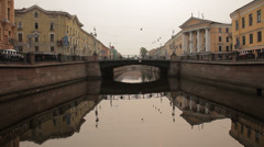 Floating Down Saint-Petersburg River in smooth motion. Under the bridge. Stock Footage