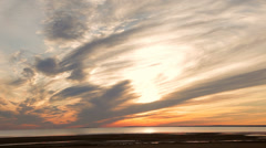 Scenic sunset over the sea. Spectacular, fantastic sky and clouds. - stock footage