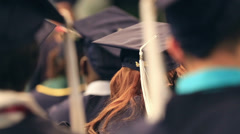Graduation class students in auditorium, cap and gown Stock Footage