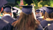 Stock Video Footage of graduation class students in auditorium, cap and gown