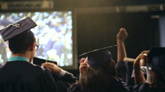 Graduation class students in auditorium - clapping Stock Footage