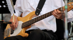 Close up on guitar, hands performing to musical instrument, watching the book Stock Footage