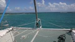 Catamaran sailing in caribbean water Stock Footage