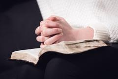 Reading bible and pray - stock photo