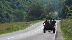 Carriage with a horse running on the rural road, people in the carriage Stock Footage