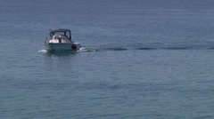 Small fishing boat navigating Stock Footage