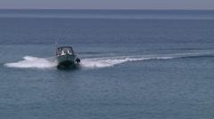 Small fishing boat navigating Stock Footage