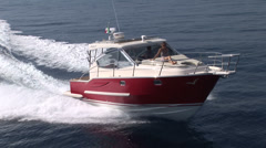 Aerial view of small boat navigating - stock footage