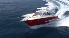 Aerial view of small boat navigating Stock Footage