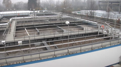 Sewage treatment plant - aeration tanks - camera pan - stock footage