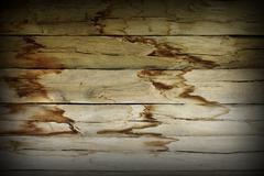 damp effects on exterior  wood wall after infiltration from damaged roof - stock photo