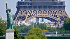 Statue of Liberty in front of the Eiffel Tower in Paris, France Stock Footage