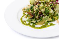 salad with rucola and pine nuts - stock photo