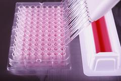 pipetting with a 12-channel pipette in laboratory - stock photo