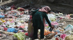 Afghan girls collects garbage to make a living Stock Footage