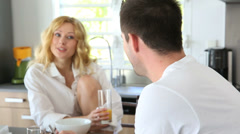 young couple having breakfast in home kitchen - stock footage