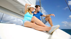 Cheerful couple cruising on a catamaran in caribbean sea Stock Footage