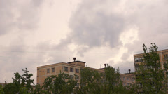 Clouds in overcast weather over buildings in the city. Timelapse. Stock Footage