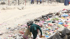Afghan girls collects plastic garbage to make a living in Kabul. - stock footage
