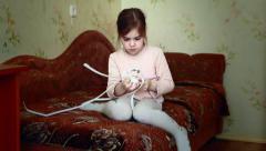 Girl makes the friendship bracelet Stock Footage