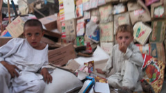 Afghan children looking into the camera Stock Footage