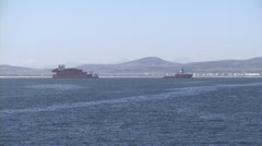 Red Ship and barge being towed in Cape Town Stock Footage