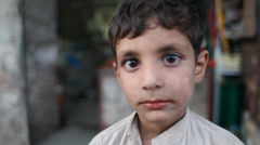 Afghan child looking into the camera Stock Footage