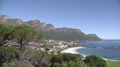 Camps Bay beach, shoreline and mountains Stock Footage