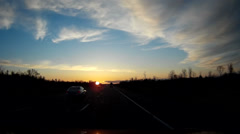 Driving shot on the highway at sunrise with blue sky and some cloud - stock footage