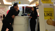 Stock Video Footage of People asking fido sales clerk about cellphone plan