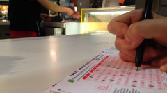 Buying lottery ticket Stock Footage