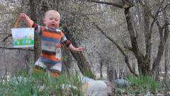 Baby on a Easter Egg Hunt. Stock Footage