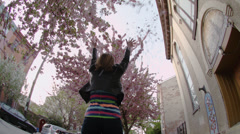 Low Angle Young Woman Throws Flower Pedals - stock footage