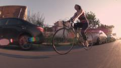Athletic Young Woman Biking at Sunset Stock Footage