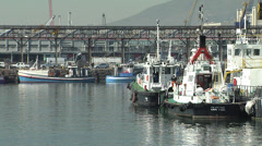 Tug boats docked in Cape Town harbour Stock Footage