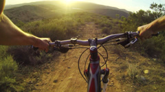 Stock Video Footage of POV Extreme Mountain Biking On Dirt Trail