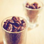 coffee beans in glasses with retro filter effect - stock photo