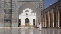 Afghan muslim walks in the blu mosque in Herat - stock footage