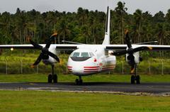 real tonga airplane arriving at lupepau'u international airport, vavau island - stock photo