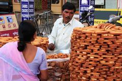 Indian man selling bread, sadar market, jodhpur, india Stock Photos
