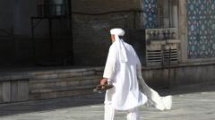 Afghan muslim prays in the blu mosque in Herat - stock footage