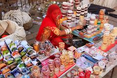 indian woman selling bangels at sadar market, jodhpur, india - stock photo